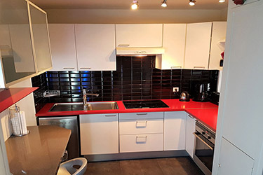 Paris center vacation rental red kitchen